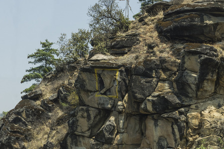 A natural formation of rockface looking like Lord Ganesh, outlined with the Nat Geo Frame, Thimphu, Bhutan