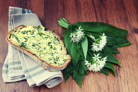 bunch of wild garlic (ramson) and bread slice with ramson butter