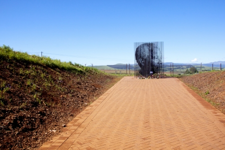 Howick, KwaZulu-Natal, South Africa - 30 December 2013: Metal sculpture of Nelson Mandela at the site where he was arrested in 1962 by the apartheid government.