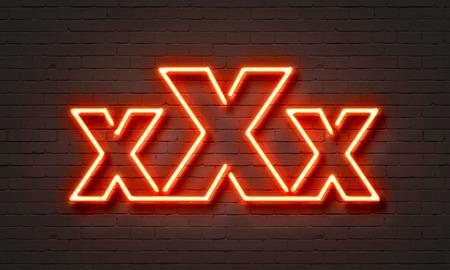 Xxx neon sign on brick wall background