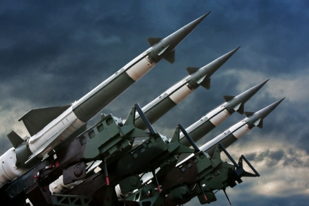 Antiaircraft  rockets on the launcher against dramatic sky.