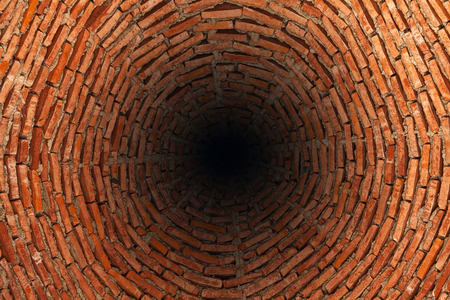 Photo for Very deep well  made of red bricks - Royalty Free Image