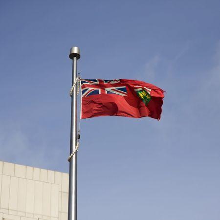 Ontario flag on a clear blue sky