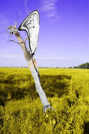 A Dali inspired image of a clock melting over a dead tree.