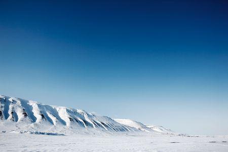 A winter mountain landscape of the island of Spitsbergen, Svalbard, Norway
