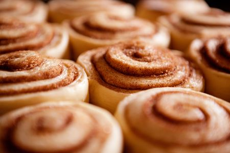 A detail of raw cinnamon buns - very shallow depth of field.