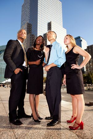 Four business people looking up. Horizontally framed shot.
