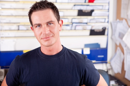 Photo for Portrait of a young man mechanic in office - Royalty Free Image
