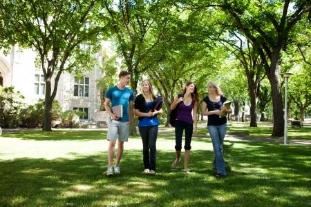 Photo pour Students walking through campus visiting - image libre de droit