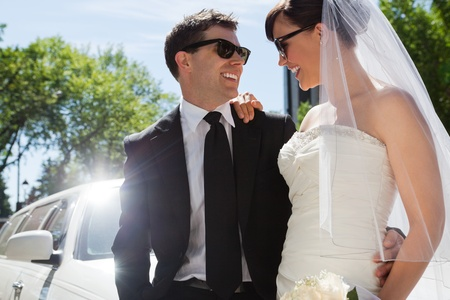 Happy married couple wearing sunglasses