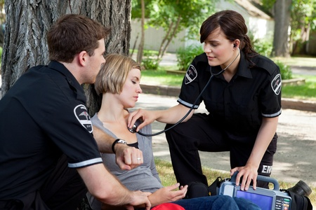Emergency medical professionals assessing an injured patient