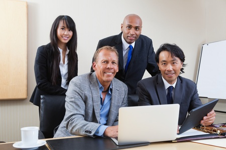 Portrait of multi ethnic businesspeople in office