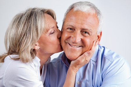 Portrait of husband being kissed by his loving wife
