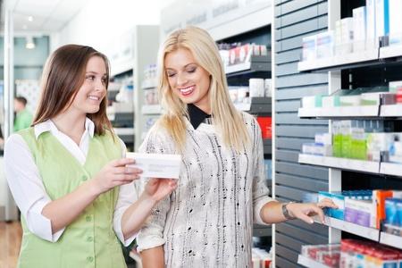 Female pharmacist advising customer at pharmacy