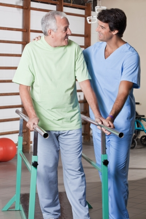 Senior man having ambulatory therapy with his therapist