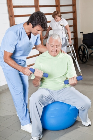 Male Physical therapist helping a patient