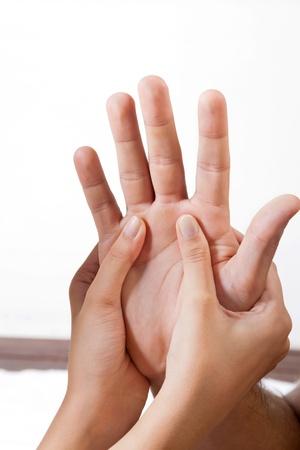Photo pour Close up of female hand s giving a palm acupressure treatment to man - image libre de droit