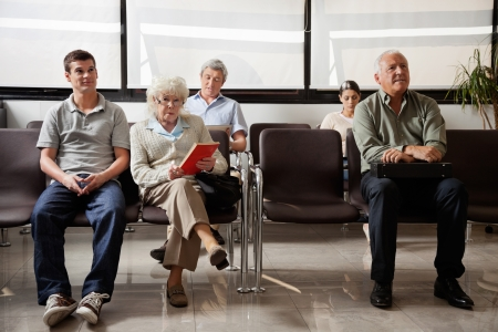 People Sitting In Hospital Lobby