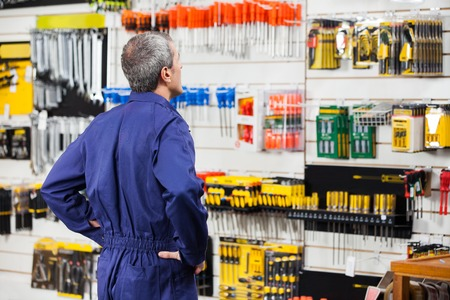 Worker With Hands On Hip In Hardware Store