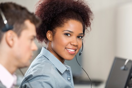 Young Customer Service Representative Working In Office