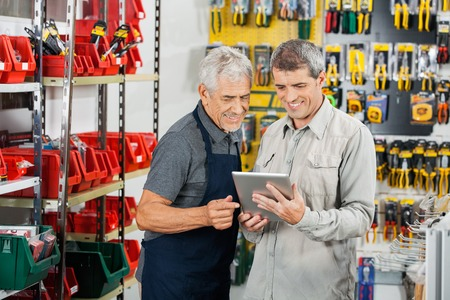 Salesperson And Customer Using Tablet Computer
