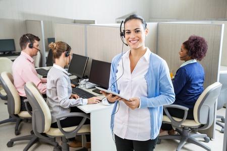 Happy Customer Service Representative Holding Tablet Computer