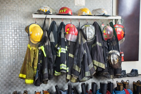 Photo for Firefighter's uniforms and gear arranged at fire station - Royalty Free Image