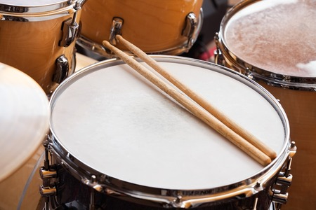 High angle view of sticks on drum in recording studio