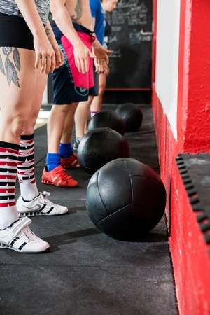 Low Section Of Clients With Medicine Balls