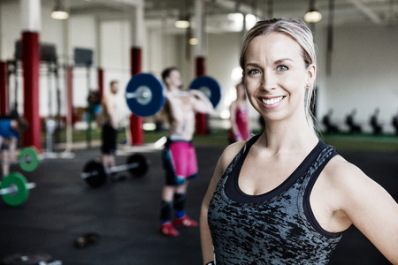 Photo for Woman Smiling In Gym - Royalty Free Image