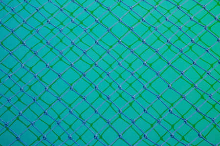 Photo for Seamless knotted pattern twisted cord in dark green background. durable material and durable for general use. - Royalty Free Image