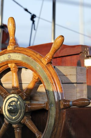 Detail of a wooden steering wheel on a vintage sailboat