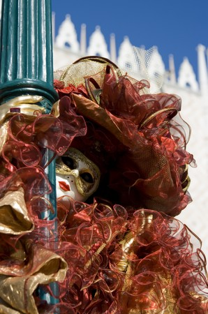 Portrait of a woman in a flamboyant costume at the carnival of Venice, Italy, 2009