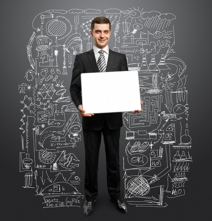 businessman holding empty write board in his hands