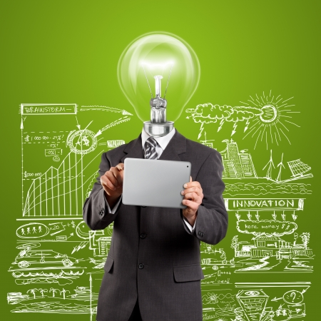 Idea concept, lamp head businessman in suit with touch pad in his hands
