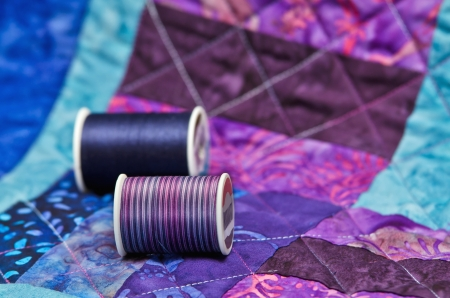 Closeup of quilt and quilting thread