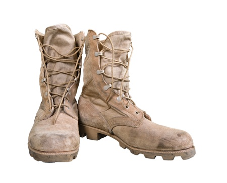 Old combat boots isolated over white