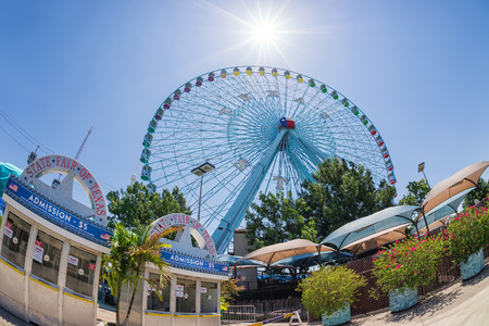 DALLAS, TX, - July 6, 2014: Texas Star, the largest ferris wheel in North America, rises above the horizon at Fair Park in Dallas, Texas. Fisheye capture.