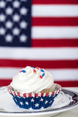 Patriotic cupcake with American flag in the background