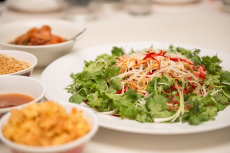 Raw fish salad  also known as Yu Sheng or Lo Hei , a Chinese New year