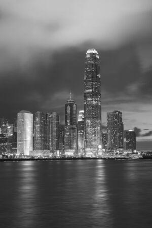 Photo for Skyline and harbor of Hong Kong city at dusk - Royalty Free Image