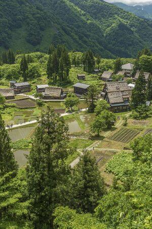 Photo for Gassho-zukuri houses in Gokayama Village. Gokayama has been inscribed on the UNESCO World Heritage List due to its traditional Gassho-zukuri houses, alongside nearby Shirakawa-go in Gifu Prefecture. - Royalty Free Image