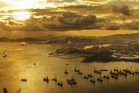 Photo for Cargo port and harbor in Hong Kong city under sunset - Royalty Free Image