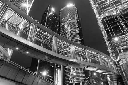 Photo pour High rise modern office building in midtown of Hong Kong city at night - image libre de droit
