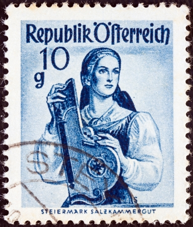 AUSTRIA - CIRCA 1948: A stamp printed in Austria from the Provincial Costumes issue shows a woman from Steiermark Salzkammergut, circa 1948.