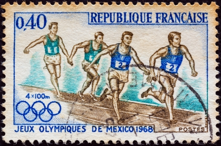 FRANCE - CIRCA 1968: A stamp printed in France from the Olympic Games, Mexico issue shows a 4x100 relay race, circa 1968.