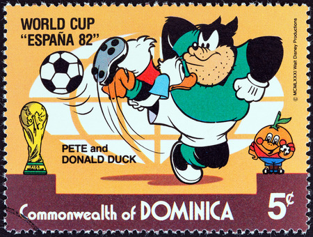 DOMINICA - CIRCA 1982  A stamp printed in Dominica from the  World Cup Football Championship, Spain  Walt Disney Cartoon Characters   issue shows Pete and Donald Duck playing, circa 1982