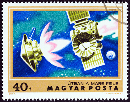 HUNGARY - CIRCA 1974: A stamp printed in Hungary from the \\\Mars Exploration \\\ issue shows Mariner 4 on course for Mars, circa 1974.