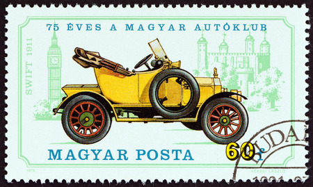 HUNGARY  CIRCA 1975: A stamp printed in Hungary from the 75th anniversary of Hungarian Automobile Club. Vintage cars  issue shows Swift 1911 and Big Ben circa 1975.