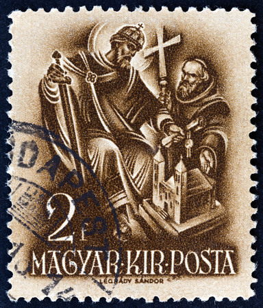 HUNGARY - CIRCA 1938: A stamp printed in Hungary from the 900th Anniversary of the Death of St.Stephen  issue shows St. Stephen, the Church Builder, circa 1938.